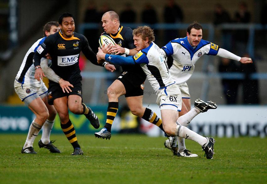 Photo: Richard Lane/Richard Lane Photography. London Wasps v Bath Rugby. LV=Cup. 14/11/2010. Wasps' Mark Van Gisbergen is tackled by Bath's Sam Vesty.