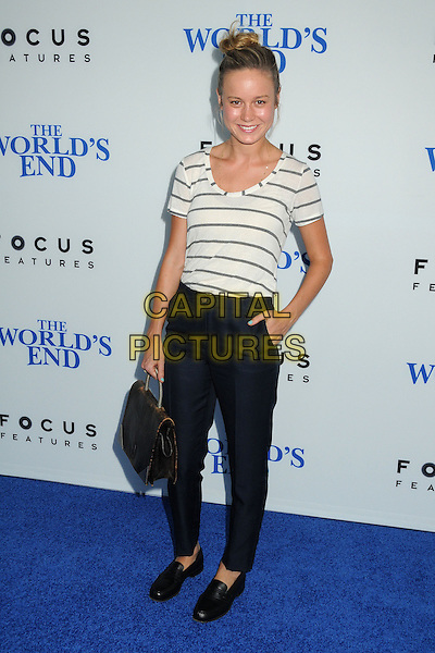 Brie Larson<br /> 'The World's End'Los Angeles Premiere held at the Cinerama Dome, Hollywood, California, USA.<br /> August 21st, 2013<br /> full length white black stripe top bag purse blue trousers hair up bun hand in pocket loafers shoes <br /> CAP/ADM/BP<br /> &copy;Byron Purvis/AdMedia/Capital Pictures