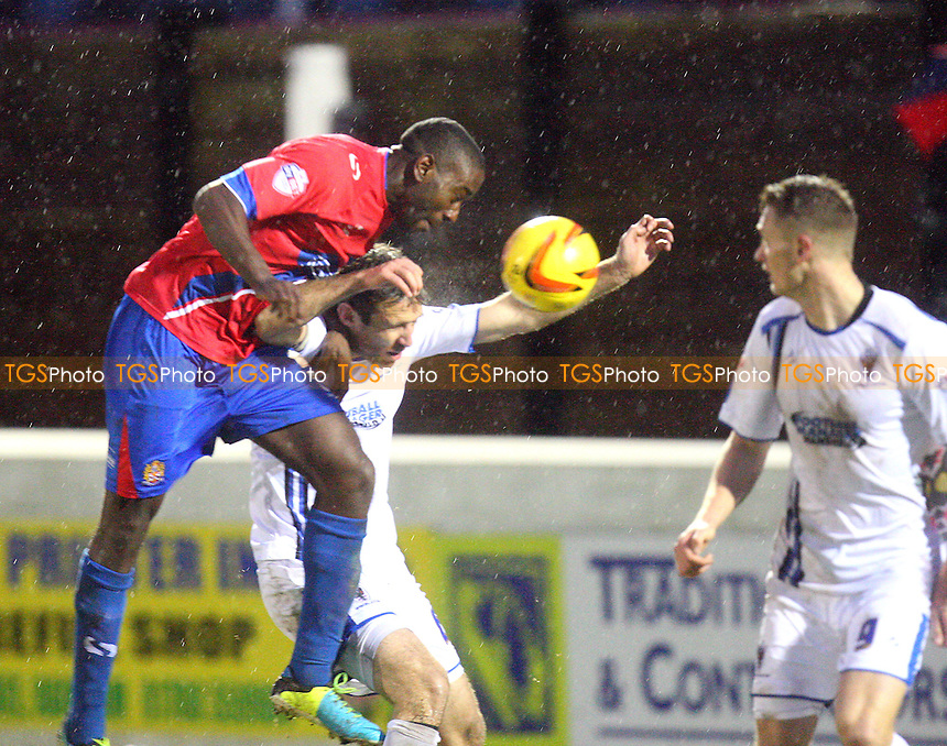 Brian Saah of Dagenham and Redbridge sees his header blocked by the arm of Alan Bennett of AFC Wimbledon - Dagenham and Redbridge vs AFC WImbledon, Sky Bet Football League football at the London Borough of Barking and Dagenham Stadium - 01/01/14 - MANDATORY CREDIT: Dave Simpson/TGSPHOTO - Self billing applies where appropriate - 0845 094 6026 - contact@tgsphoto.co.uk - NO UNPAID USE