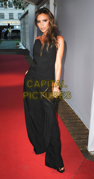 Victoria Beckham<br /> Glamour Women of the Year Awards - Outside arrivals - at Berkeley Square Gardens, London, England.<br /> June 4th 2013<br /> full length black strapless jumpsuit gold clutch bag<br /> CAP/PP/GM<br /> &copy;Gary Mitchell/PP/Capital Pictures
