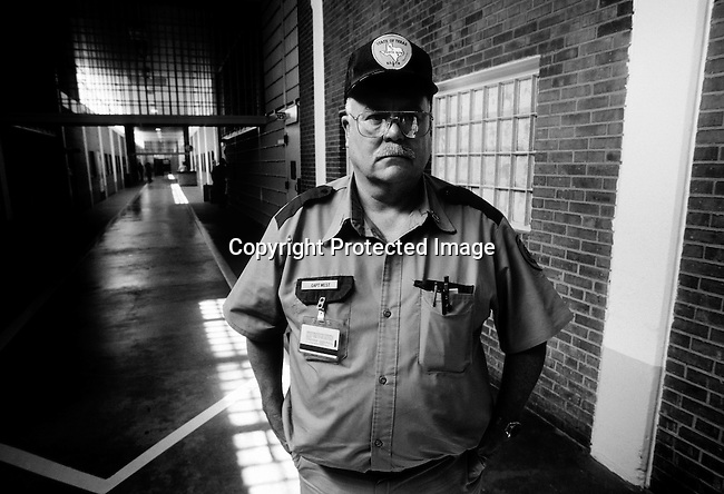 Texas Death Row Captain Billy West stands in the corridor on April 14, 1997 at Ellis Unit in Huntsville, Texas USA. The prison has about 450 prisoners on death row. The state leads all records in executing people around the US. The prisoners are executed by lethal injection. (Photo by: Per-Anders Pettersson)...