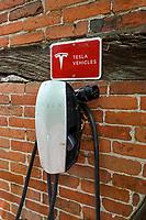 Germany, Tesla e-automobile, electric charging station at home / DEUTSCHLAN, Friedrichsruh, Ladestation fuer das E-Auto Tesla an einer Fachwerkfassade