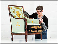 BNPS.co.uk (01202 558833)<br /> Pic: PhilYeomans/BNPS<br /> <br /> Conservator Emma Telford with a restored chair.<br /> <br /> Seat of Power - The First Duke of Marlborough&rsquo;s campaign chairs, upon which he sat to plot the downfall of the French King Louis XIV, are returning to Blenheim Palace following an 18-month restoration.<br /><br />The chairs would have been carted across Europe as part of the Duke&rsquo;s baggage train to allow him a comfortable seat in which to plan his stunningly successful campaign against the mighty French monarch.<br /><br />Textile conservator Emma Telford, who is based in Herefordshire, had to turn detective to re-discover the ornate 18th century chairs&rsquo; original decoration and recruit a team of embroiders to help bring them back to life.<br /><br />In total Emma and her volunteer helpers used a staggering 10,000 metres of French silk to re-embroider the chairs with the original designs.
