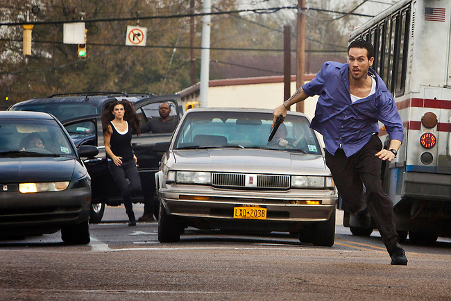 In this episode of Breakout Kings, trapped in a traffic jam, Cruz abandons his vehicle and makes a run for it with Erica and Shea (Malcolm Goodwin) hot on his trail.  Photo: Skip Bolen / A&E Television Networks