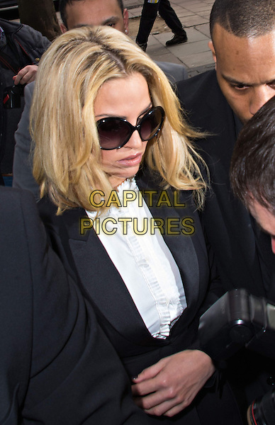 Sarah Harding court appearance.  Former Girls Aloud star appears in court charged with using her mobile phone while driving and failing to stop her car for police, after an incident in central London on April 4.  Highbury Magistrates' Court, 51 Holloway Road, London, England..16th April 2013.half length black suit blazer jacket white shirt blouse sunglasses shades .CAP/BF.©Bob Fidgeon/Capital Pictures