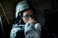 US ARMY Specialist Kahaya Komar inside her armored personnel carrier during  a day long logistical mission between Jalalabad and The Pech Valley in Kunar province, Afghanistan on Wednesday  May 1, 2010...Specialist Komar is a radio operator and assistant gunner on logistical convoys with Destro Platoon, Fury Company, 2nd Battalion, 4th Brigade, Task Force Mountain Warrior, 4th Infantry Division..