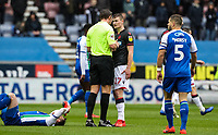Bolton Wanderers' Callum Connolly is spoken to by referee Robert Jones <br /> <br /> Photographer Andrew Kearns/CameraSport<br /> <br /> The EFL Sky Bet Championship - Wigan Athletic v Bolton Wanderers - Saturday 16th March 2019 - DW Stadium - Wigan<br /> <br /> World Copyright &copy; 2019 CameraSport. All rights reserved. 43 Linden Ave. Countesthorpe. Leicester. England. LE8 5PG - Tel: +44 (0) 116 277 4147 - admin@camerasport.com - www.camerasport.com