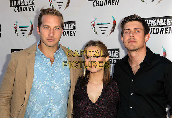 Ryan Hansen, Kristen Bell, Chris Lowell<br /> 1st Annual Founders Party For The Invisible Children's 4th Estate Leadership Summit Held At Royce Hall, UCLA, Los Angeles, California, USA, 10th August 2013.<br /> half length black blue print red shirt <br /> CAP/ADM/KB<br /> &copy;Kevan Brooks/AdMedia/Capital Pictures
