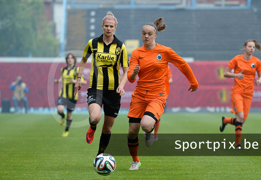 20150514 - BEVEREN , BELGIUM : sprinting duel pictured between Tine De Caigny (right) and Justine Vanhaevermaet (left) during the final of Belgian cup, a soccer women game between SK Lierse Dames and Club Brugge Vrouwen , in stadion Freethiel Beveren , Thursday 14 th May 2015 . PHOTO DAVID CATRY