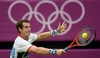29.07.2012.  London, England.  Andy Murray of Britain participates in the Mens Tennis tournament at The 2012 Summer Olympic Games at Wimbledon