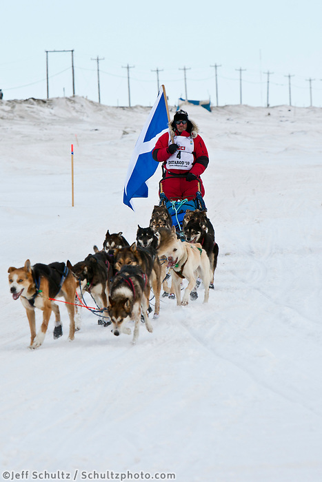 Scottish musher, Wattie McDonald, mushes on the Bering Sea on the way to the Nome during the 2010 Iditarod