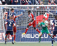 FC Dallas goalkeeper Raul Fernandez (1) concentrates on crossed ball..  In a Major League Soccer (MLS) match, FC Dallas (red) defeated the New England Revolution (blue), 1-0, at Gillette Stadium on March 30, 2013.