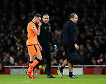 Liverpool's Jordan Henderson goes off injured during the premier league match at the Emirates Stadium, London. Picture date 22nd December 2017. Picture credit should read: David Klein/Sportimage