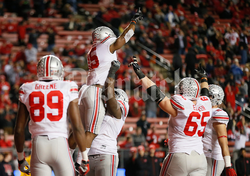 Ohio State Buckeyes offensive lineman Chase Farris (57) and Ohio State Buckeyes running back Ezekiel Elliott (15) celebrate Elliott's touchdown in the fourth quarter of the college football game between the Rutgers Scarlet Knights and the Ohio State Buckeyes at High Point Solutions Stadium in Piscataway, NJ, Saturday night, October 24, 2015. The Ohio State Buckeyes defeated the Rutgers Scarlet Knights 49 - 7. (The Columbus Dispatch / Eamon Queeney)
