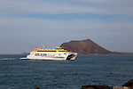 Fred Olsen Express ferry ship passing Los Lobos island, Corralejo, Fuerteventura, Canary Islands, Spain
