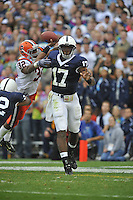 12 September 2009:  Penn State QB Daryll Clark rolls out and throws as Syracuse's Doug Hogue (32) hits him as he throws.  Clark threw for 240 yards and 3 TDs.  The Penn State Nittany Lions defeated the Syracuse Orangemen 28-7 at Beaver Stadium in State College, PA..