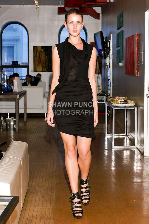 Model walks the catwalk in an asymmetrical draped scarf dress by Ji Oh, during the Shadowconnected S/S 11 presentation at Nexus Showroom, September 2nd, 2010.