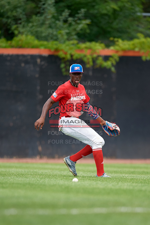 Yoansy Moreno (12) fields a ball in the outfield during the Dominican Prospect League Elite Underclass International Series, powered by Baseball Factory, on July 21, 2018 at Schaumburg Boomers Stadium in Schaumburg, Illinois.  (Mike Janes/Four Seam Images)