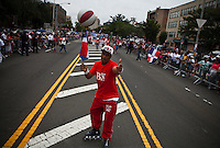 A Dominican man takes part during the Bronx Dominican parade in New York July 28, 2013 by Kena Betancur / VIEWpress