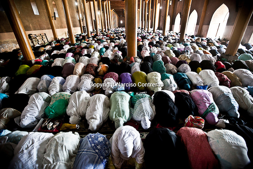 Kashmri muslim women praying at the Jamia Masjid or grand mosque at midday in Srinagar as the main duty to observe the holy month of Ramadan. As the tradition is attended muslims has to fast from dawn to dusk, where they refrain from eating, drinking and smoking.