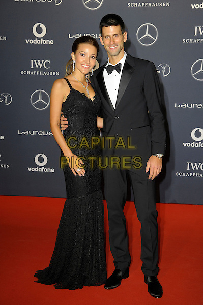 Jelena Ristic & Novak Djokovic.Arrivals at the Laureus 2012 World Sports Awards held at the Queen Elizabeth II Centre, London, England..February 6th, 2012.full length black tuxedo dress.CAP/CAS.©Bob Cass/Capital Pictures.