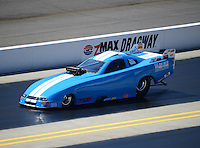 Apr. 14, 2012; Concord, NC, USA: NHRA top alcohol funny car driver Wayne Morris during qualifying for the Four Wide Nationals at zMax Dragway. Mandatory Credit: Mark J. Rebilas-