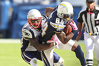 10/24/10 San Diego, CA: New England Patriots cornerback Kyle Arrington #27 and San Diego Chargers wide receiver Buster Davis #84 during an NFL game played at Qualcomm Stadium between the San Diego Chargers and the New England Patriots. The Patriots defeated the Chargers 23-20.