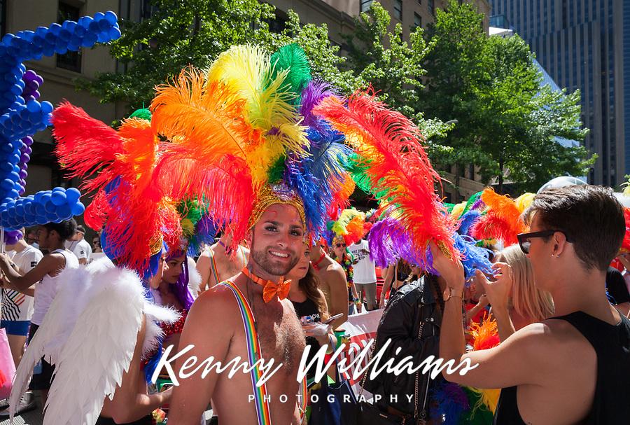 Man wearing rainbow color feather Headdress, Seattle Pride Parade 2016, Washington, USA.