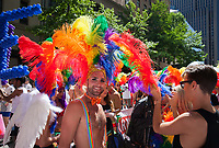 Man wearing rainbow color feather Headdress, Seattle Pride Parade 2016, Washington, USA.