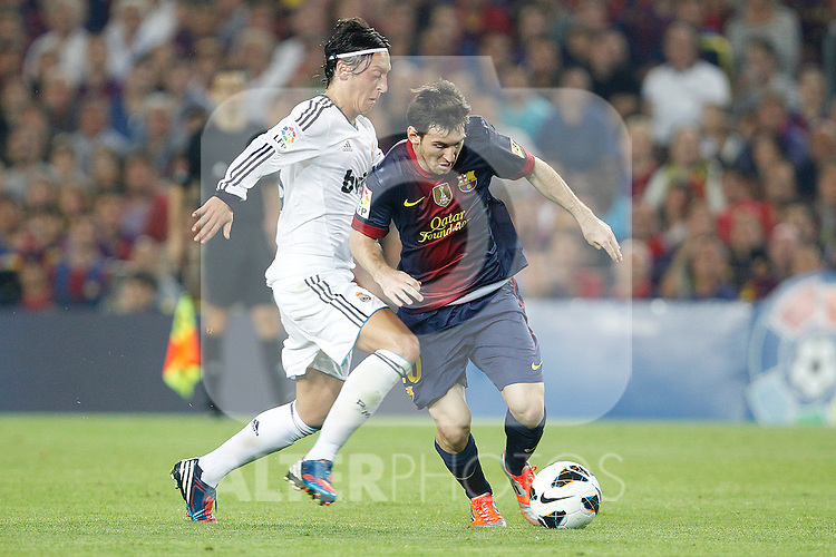 Barcelona's Lionel Messi and Real Madrid's Mesut Ozil during la Liga match on october 7th 2012. ..Photo: Cesar Cebola  / ALFAQUI