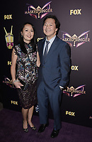 WEST HOLLYWOOD, CA - DECEMBER 13: Panelist Ken Jeong (R) and Tran Jeong attend the premiere karaoke event for season one of THE MASKED SINGER on Thursday, Dec.13 at The Peppermint Club in West Hollywood, California. (Photo by Scott Kirkland/FOX/PictureGroup)