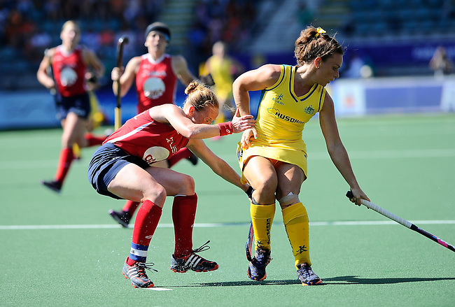 The Hague, Netherlands, June 12: Georgie Parker #19 of Australia defends the ball against Lauren Crandall #27 of USA during the field hockey semi-final match (Women) between USA and Australia on June 12, 2014 during the World Cup 2014 at Kyocera Stadium in The Hague, Netherlands. Final score after full time 2-2 (0-1). Score after shoot-out 1-3. (Photo by Dirk Markgraf / www.265-images.com) *** Local caption ***