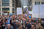 Crowds listening to political speeches before a demonstration by the Alternative für Deutschland (AfD) political party through the centre of Berlin. Around 5000 supporters of the AfD took part in the march and rally calling on German Chancellor Angela Merkel to halt the influx of refugees into the country. Around one million refugees from the Middle East and north Africa arrived in Germany during 2015, 50,000 of whom came to Berlin.