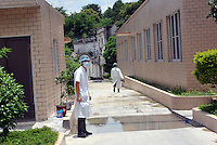 Workers at the Guangzhou Blooming Spring Biological Technology Development Co, Ltd in Guangdong Province, China. The company is building the biggest monkey farm in the world in the world holding 50,000 monkeys. The monkeys are bred solely for export to the US and Europe where pharmaceutical and cosmetic companies use them vivisection...SINOPIX PHOTO.