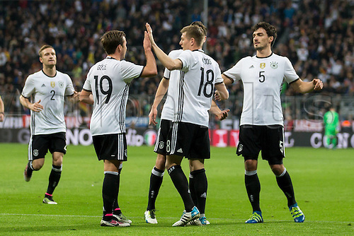 29.03.2016. Munich, Germany. International soccer match between Germany and Italy, at the Allianz Arena in Munich.  Shkodran Mustafi (GER ), Mario Goetze (GER 19), Toni Kroos (GER 18) and Mats Hummels (GER 5) celebrate their goal for 1:0