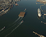 Aerial photographs of the Tugboat, Ranger (Crowley Maritime) pulling 17 barges through the New York Harbor<br /> 3/25/2009.