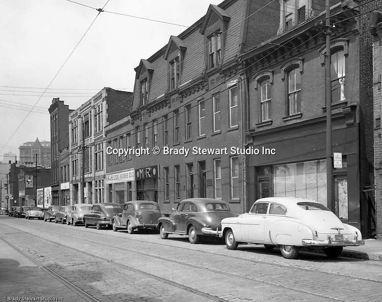 Pittsburgh PA:  View of Forbes Avenues and Magee Street in the uptown section of Pittsburgh near Duquesne University - 1950.  Assignment was for a developer trying to get some of the buildings condemned so he could get them at a good price for future development.