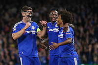 Willian of Chelsea (right) celebrates scoring the opening goal against Maccabi Tel Aviv with Gary Cahill of Chelsea (left) during the UEFA Champions League match between Chelsea and Maccabi Tel Aviv at Stamford Bridge, London, England on 16 September 2015. Photo by David Horn.