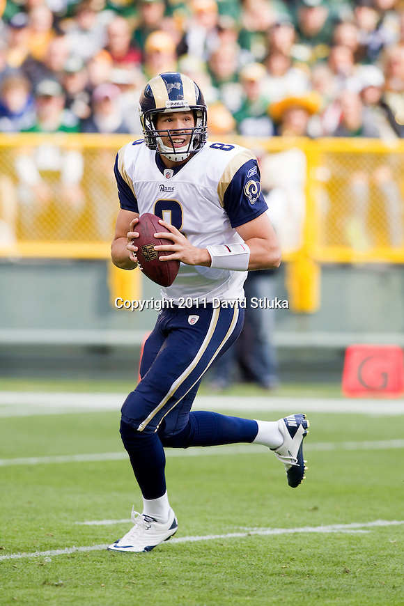 St. Louis Rams quarterback Sam Bradford (8) looks for a receiver during a Week 6 NFL football game against the Green Bay Packers on October 16, 2011 in Green Bay, Wisconsin. The Packers won 24-3. (AP Photo/David Stluka)