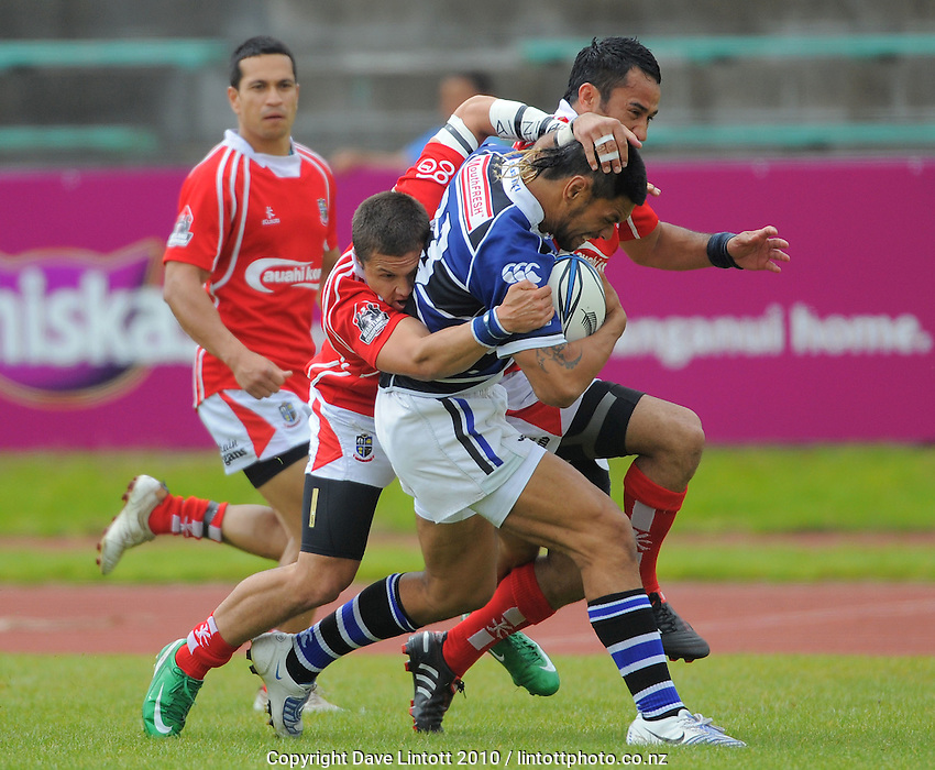 Wanganui centre Tau Moeke is wrapped up. AA Rewards Heartland Championship - Meads Cup semifinal, Wanganui v Poverty Bay  at Cooks Gardens, Wanganui, New Zealand on Saturday, 23 October 2010. Photo: Dave Lintott / lintottphoto.co.nz