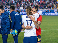 HARRISON, NJ - MARCH 08: Tobin Heath #17 of the United States hugs Jennifer Hermoso #10 of Spain during a game between Spain and USWNT at Red Bull Arena on March 08, 2020 in Harrison, New Jersey.