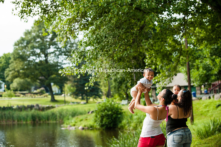 WATERBURY, CT-28 July 2014-072814EC01-  Wild Art. Catherine Diaz plays with her baby Jadiel Diaz Monday afternoon at Fulton Park in Waterbury. Next to her is Lissette Cancel and her daughter Adrianna Irizarry. Erin Covey Republican-American