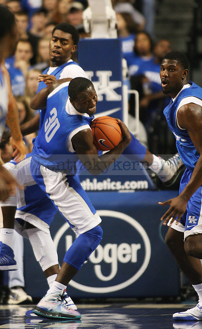 Kentucky Wildcats forward Julius Randle (30) grabs a rebound ball during the first half of the Blue-White scrimmage at Rupp Arena in Lexington, Ky., on Tuesday, October 29, 2013. Photo by Tessa Lighty | Staff