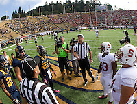 California and Stanford captains watch referee Jack Folliard tosses a coin during coin toss ceremony before 115th Big Game at Memorial Stadium in Berkeley, California on October 20th, 2012.  Stanford defeated California, 21-3.
