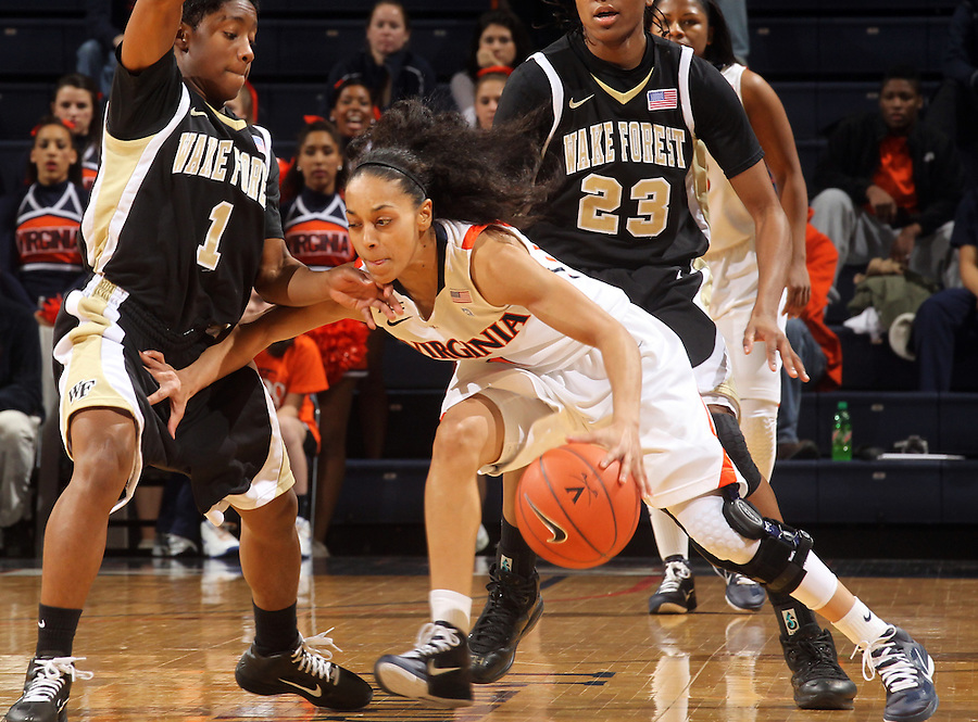 Feb. 3, 2011; Charlottesville, VA, USA; Virginia Cavaliers guard China Crosby (1) is defended by Wake Forest Demon Deacons guard Brooke Thomas (1) and Wake Forest Demon Deacons guard Secily Ray (23) during the game at the John Paul Jones Arena.  Mandatory Credit: Andrew Shurtleff