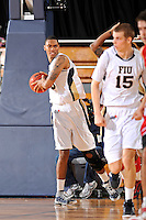 28 January 2012:  FIU guard-forward Dominique Ferguson (3) pulls down a rebound in the second half as the Western Kentucky University Hilltoppers defeated the FIU Golden Panthers, 61-51, at the U.S. Century Bank Arena in Miami, Florida.