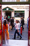 A082NC Entrance to Chinese restaurant with people passing by Chinatown Soho London England