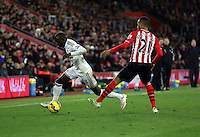 Pictured L-R: Modou Barrow of Swansea is fouled by Ryan Bertrand of Southampton Sunday 01 February 2015<br /> Re: Premier League Southampton v Swansea City FC at ST Mary's Ground, Southampton, UK.
