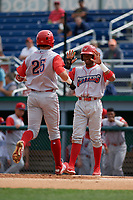 Williamsport Crosscutters Johan Rojas (right) greets Hunter Hearn (25) after a home run during a NY-Penn League game against the Batavia Muckdogs on August 27, 2019 at Dwyer Stadium in Batavia, New York.  Williamsport defeated Batavia 11-4.  (Mike Janes/Four Seam Images)