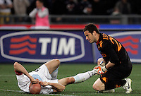 Calcio, Serie A: Lazio-Roma. Roma, stadio Olimpico, 18 aprile 2010..Football, Italian serie A: Lazio-Roma. Rome, Olympic stadium, 18 aprile 2010. Lazio forward Tommaso Rocchi is helped by AS Roma goalkeeper Julio Sergio, of Brazil, right, after being injured..UPDATE IMAGES PRESS/Riccardo De Luca